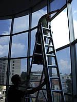 Установка бронирующих (защитных) пленок на стекла зданий - бронирование стекол    http://a-sun.dp.ua