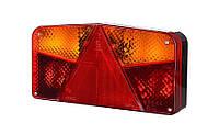 Задний, комбинированный фонарь с треугольником и двумя указателями поворота, левый с противотуманным светом (межцентровое отверстие 150,7 мм),