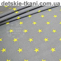 Ткань хлопковая с ярко-жёлтыми звёздами на тёмно-сером фоне (№ 662).