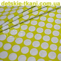 Ткань бязь горчичного цвета с густыми горохами размером 3 см (№ 674а).