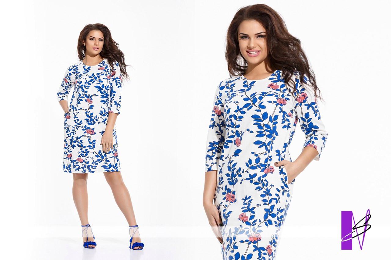Батальное женское платье свободного силуэта с карманами