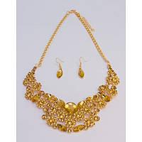 Колье золотистое с желтыми камнями