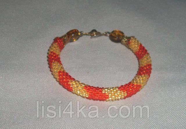 Узорный браслет-жгут из чешского бисера желто-оранжевый узорный