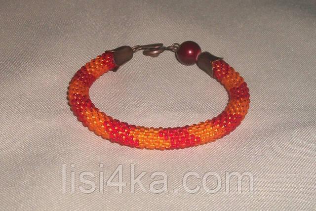 Узорный браслет-жгут из чешского бисера красно-оранжевый узорный