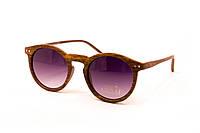 Круглые очки под дерево