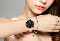 Женские часы на металлическом браслете