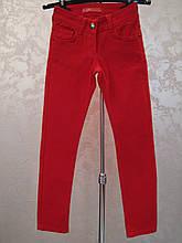 Коттоновые зауженные брюки на девочек 128,134 роста Красные