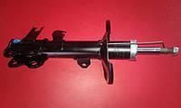 Амортизатор передний левый Geely Emgrand EC7 1064001256