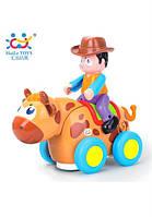 Музыкальная игрушка huile toys Ковбой на диком быке (838b)