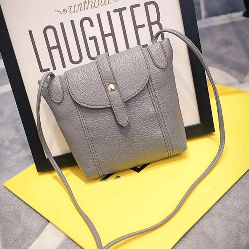 Женская сумочка через плечо серого цвета