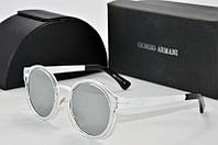 Солнцезащитные очки Armani круглые в прозрачной оправе