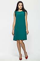Яркое женственное зеленое платье, расклешенное к низу