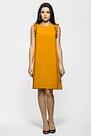Яркое женственное горчичное платье, расклешенное к низу