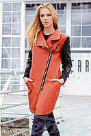 Плотная экокожаная куртка. Цвет оранжево-черный.