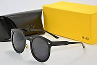 Солнцезащитные очки круглые Fendi черные