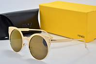 Солнцезащитные очки Fendi золотые