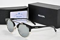 Солнцезащитные очки Prada зеркальные