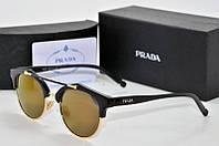 Солнцезащитные очки Prada золотые
