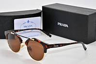 Солнцезащитные очки Prada коричневые