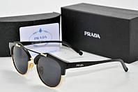 Солнцезащитные очки Prada черные с золотом