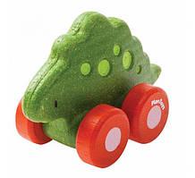 Plan Toys - Деревянная игрушка Стегозавр на колёсиках