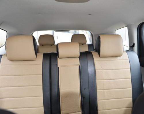 Авточехлы из экокожи черные с бежевым на  Mitsubishi Pajero Sport  2 с 2008-2013г. джип. 5Мест.