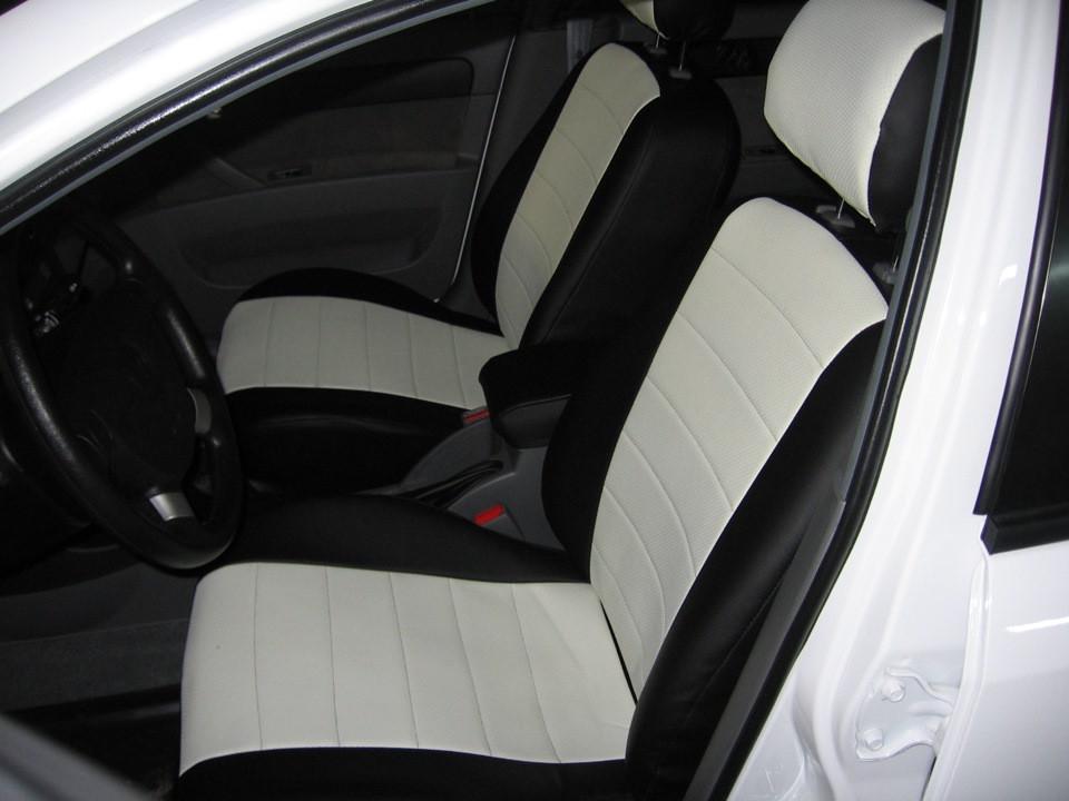 Авточехлы из экокожи черные с белым на  Toyota Corolla 10 с 2006-2012г. седан. (E140, E150)