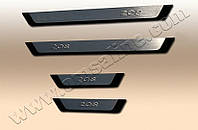 Накладки на пороги Peugeot 208 (2012-) (нерж.) 4 шт. (Flexill - надпись)