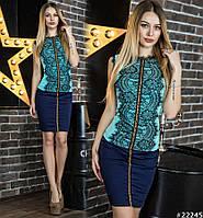 Элегантный приталенный комплект состоит из облегающей юбки - карандаш, и красивой блузки без рукавов.