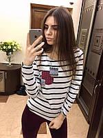 Женский свитер в полоску