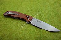 Нож складной из прочной стали,достоин внимания  (красное дерево )