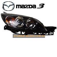 Оригинальная передняя фара в сборе с заводстким ксеноном (правая сторона б/у) Mazda 3 BK хэтчбек
