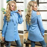 Стильная рубашка-туника с оригинальными вырезами на плечах, декорированная завязкой-бантом на горловине.