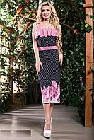 Яркое платье, сочетающее в себе стильный принт и пышную оборку на груди