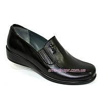 Закрытые женские туфли из натуральной кожи черного цвета
