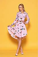 Молодежное розовое платье-трапеция с асимметричным низом