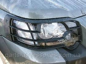 Захисні накладки на передні фари Land Rover Freelander 2003-2006 Нові