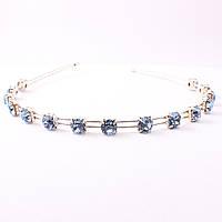 Обруч металлический на серебристой основе декорирован голубыми кристаллами