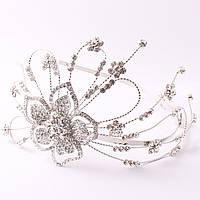 Обруч из металла на серебристой основе декорирован цветком