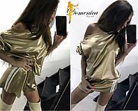 Модный женский костюм в золотом цвете