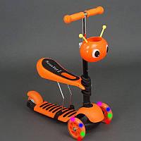 Самокат 3-х колесный 4115 оранжевий,сиденье,корзинка,колеса PU,свет,в кор.