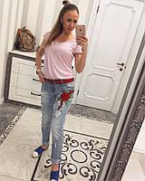 Женские джинсы с вышивкой и прорезами
