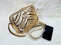 Сумка-клатч через плечо Gucci Гуччи золотая