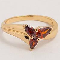 Кольцо золотистое с красным камушком