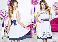 Стильное приталенное платье из креп-шифона с перфорацией и украшением из камней на талии