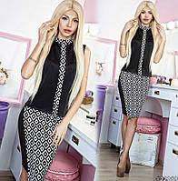 Стильный костюм для настоящей бизнес-леди. Комплект состоит из блузки без рукавов и юбки до колена.