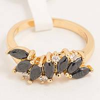 Кольцо золотистое с черными камнями