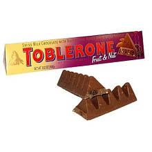 Шоколад Toblerone Молочный с изюмом и нугой 100г