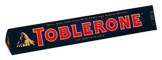 Шоколад Toblerone горький с медом, миндалем и нугой 100 г
