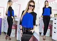 Элегантный строгий образ в формальном стиле. Образ состоит из тонкой блузы, черных брюк.